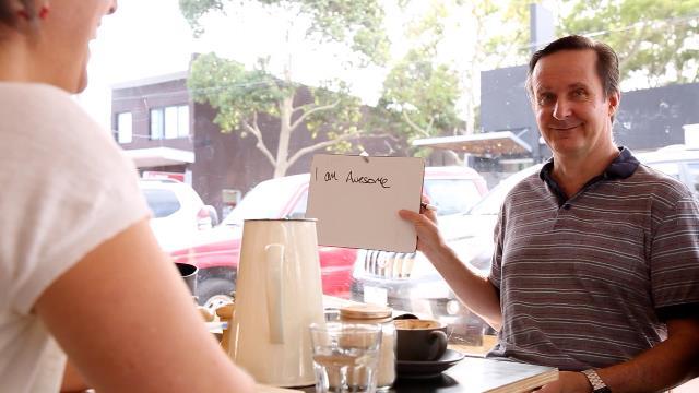 Man holding sign up saying 'I am awesome'